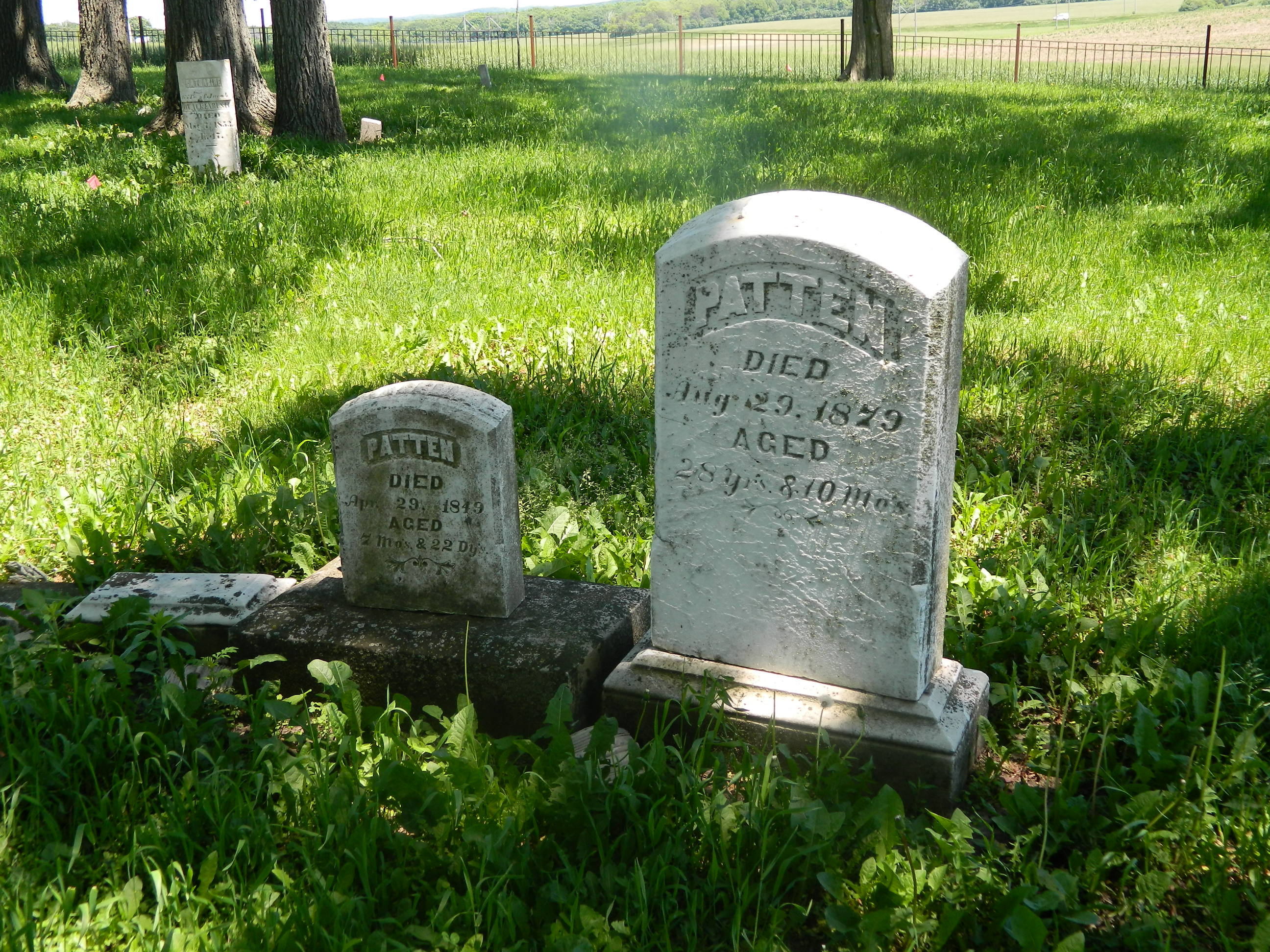 Markers for the graves of members of the Patten family